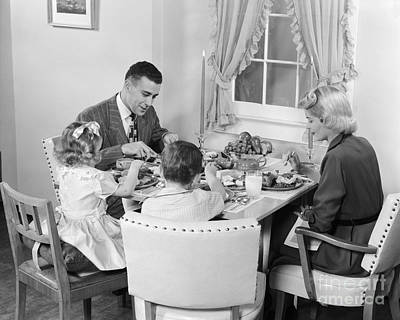Urban Style Clothes Photograph - Family Having Dinner, C.1950s by H. Armstrong Roberts/ClassicStock