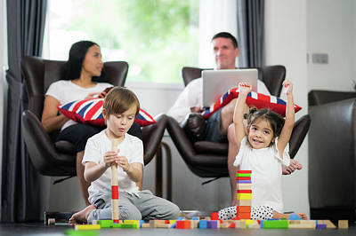 Photograph - Family In Living Room Play Wooded Toy by Anek Suwannaphoom