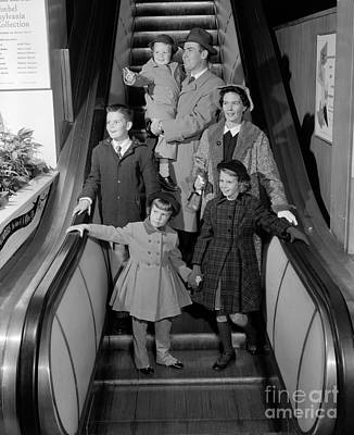 Family On Escalator, C.1950s Art Print by H. Armstrong Roberts/ClassicStock