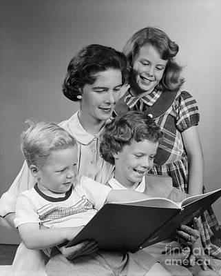 Preteen Photograph - Family Reading Book Together, C.1950s by H. Armstrong Roberts/ClassicStock
