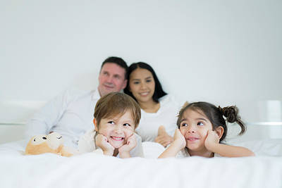 Photograph - Family Relax On The Bed In Bedroom by Anek Suwannaphoom