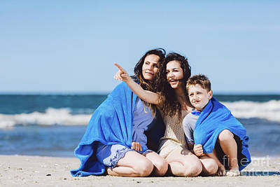 Photograph - Family Sitting On A Beach, Older Sister Pointing Her Finger by Michal Bednarek