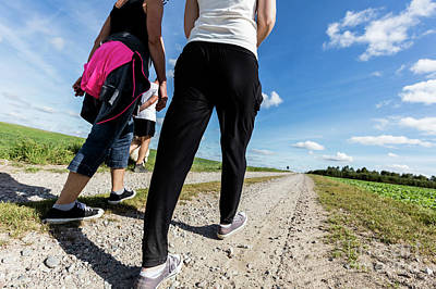 Trekking Photograph - Family Walk In Countryside On A Sunny Day. Legs Perspective by Michal Bednarek