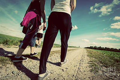 Outdoors Photograph - Family Walk In Countryside On A Sunny Day. Legs Perspective. Vintage Look by Michal Bednarek