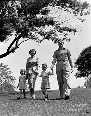 Family Walking In Park, C.1950s Art Print
