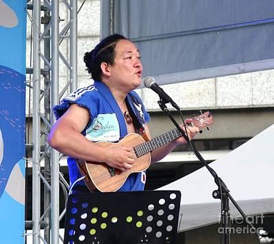 Concert Ukulele Photograph - Famous Japanese Ukulele Artist Performs by Yali Shi