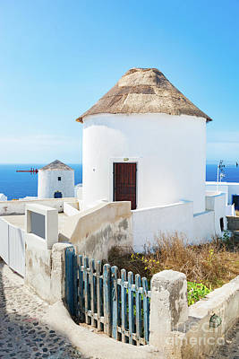 Photograph - Famous Windmills In Oia Town On Santorini Island, Greece. by Michal Bednarek