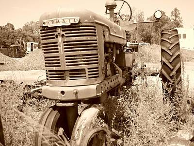 Abandonded Tractor Photograph - Farmall In Sepia by Lynda Dawson-Youngclaus