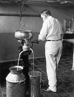 Milk Can Photograph - Farmer Using A Cream Separator by Underwood Archives