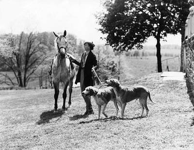 Equestrian Clothes Photograph - Fashionable Woman With Horse And Dogs by H. Armstrong Roberts/ClassicStock