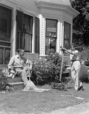 Father And Son Outside Talking, C.1940s Art Print by H. Armstrong Roberts/ClassicStock