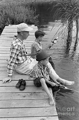 Father And Son Photograph - Father And Sons Fishing by H. Armstrong Roberts/ClassicStock