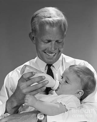 Father Bottle-feeding Baby, C.1960s Art Print by H. Armstrong Roberts/ClassicStock