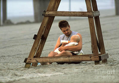 Father And Son Photograph - Father Feeding His Baby Son by George Mattei