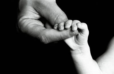 Colored Background Photograph - Father Holding Hand Of Baby by Sami Sarkis