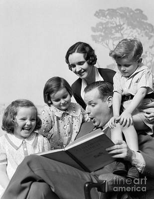 Story-1920s Photograph - Father Reading To Family, C.1930s by H. Armstrong Roberts/ClassicStock