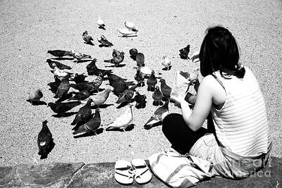 Photograph - Feeding The Pigeons In Mykonos by John Rizzuto