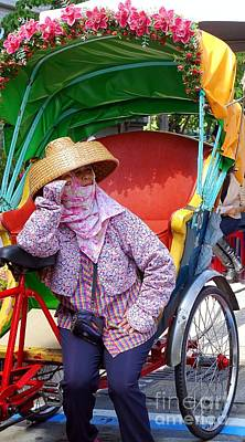 Photograph - Female Pedicab Driver Waits For Customers by Yali Shi