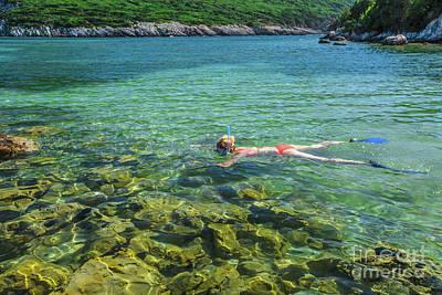 Female Snorkeler In Tropical Sea Art Print