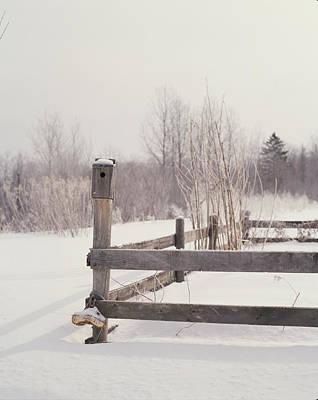 Fence And Birdhouse In The Snow Print by Gillham Studios