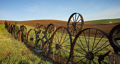 Wagon Wheels Photograph - Fence Of Wheels by Mary Lee Dereske