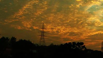 Venice Beach Bungalow - Fiery clouds by Nilu Mishra