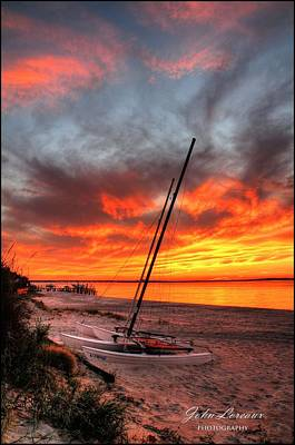 Photograph - Fiery Sunset by John Loreaux