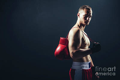 Photograph - Fighter Standing With Gloves Hanging Over His Back. by Michal Bednarek