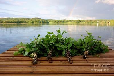 Finland Photograph - Finnish Sauna Whisks On Wooden Pier by Mikko Palonkorpi
