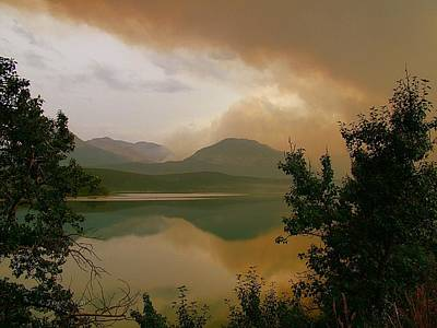 Beaches And Waves Rights Managed Images - Fire Over St Mary Lake Royalty-Free Image by Tracey Vivar