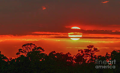 Photograph - Fireball Sunset by Tom Claud