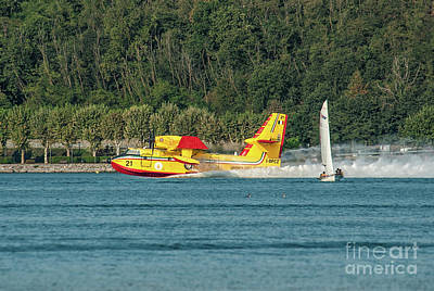 Aviation Photograph - Firefighter In Action With A Bombardier Cl-415 by Roberto Chiartano