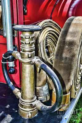 Photograph - Fireman Its All About The Nozzle by Paul Ward