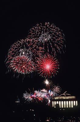 Fireworks Light Up The Night Sky Print by Stocktrek Images