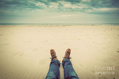 Angle Photograph - First Person Perspective Of Man Legs In Jeans On The Autumn Beach by Michal Bednarek
