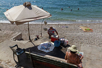 Athens Photograph - Fish Catch By The Lady On The Beach by Iordanis Pallikaras