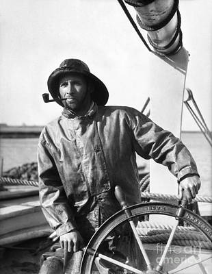 Archetype Photograph - Fisherman At Wheel, C.1920-30s by H. Armstrong Roberts/ClassicStock