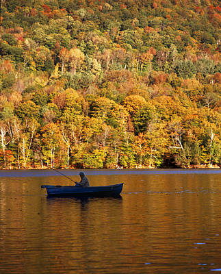 Fisherman In Boat With Fall Foliage Art Print by Gillham Studios