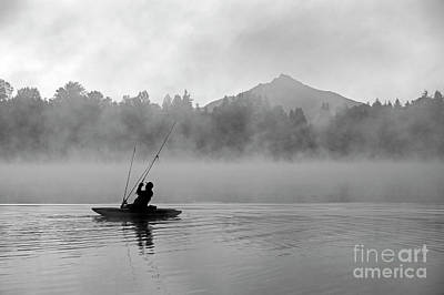 Photograph - Fisherman On Lake Cassidy Casting Fishing Line  by Jim Corwin