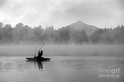 Photograph - Fisherman On Lake Cassidy Casting Fishing Line  by Jim Corwin