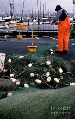 Photograph - Fisherman's Terminal Fixing Nets by Jim Corwin