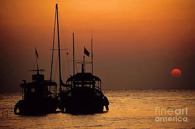 Fishing Boats Together At Sunset Art Print by Sami Sarkis