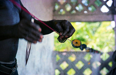 Photograph - Fishing Net Mending by Muyiwa OSIFUYE