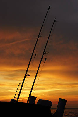 Photograph - Fishing Poles At Sunset by Daniel Woodrum