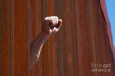 Photograph - Fist Through Border Fence by Jim West