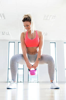 Athletic Photograph - Fit Woman Doing A Squat With Kettlebell. by Michal Bednarek