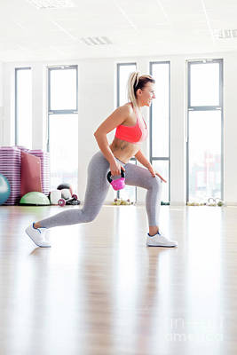 Athletic Photograph - Fit Woman Doing Lunge Exercise With Kettlebell. by Michal Bednarek