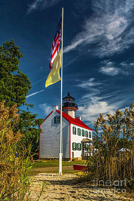 Photograph - Flags At East Point Lighthouse by Nick Zelinsky