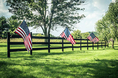 Photograph - Flags on Fence by Ray Sheley