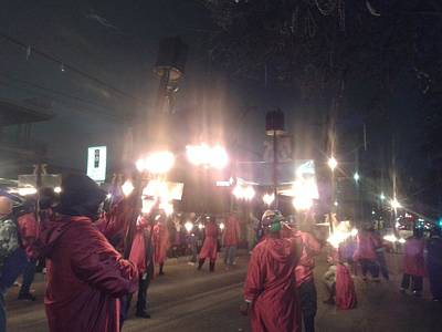 Photograph - Flambeau Carriers Illuminate The Streets During  Lundi Gras  by Michael Hoard